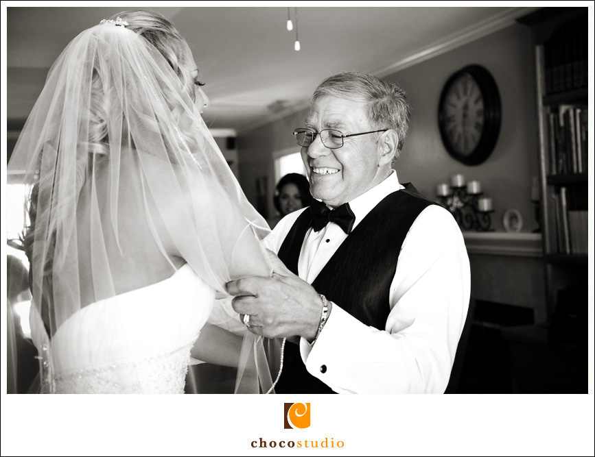 Bride with her father getting ready for ceremony