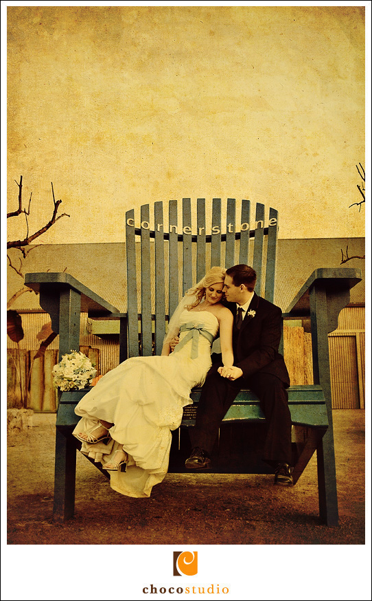 Bride and Groom on giant chair at Cornerstone Gardens Wedding