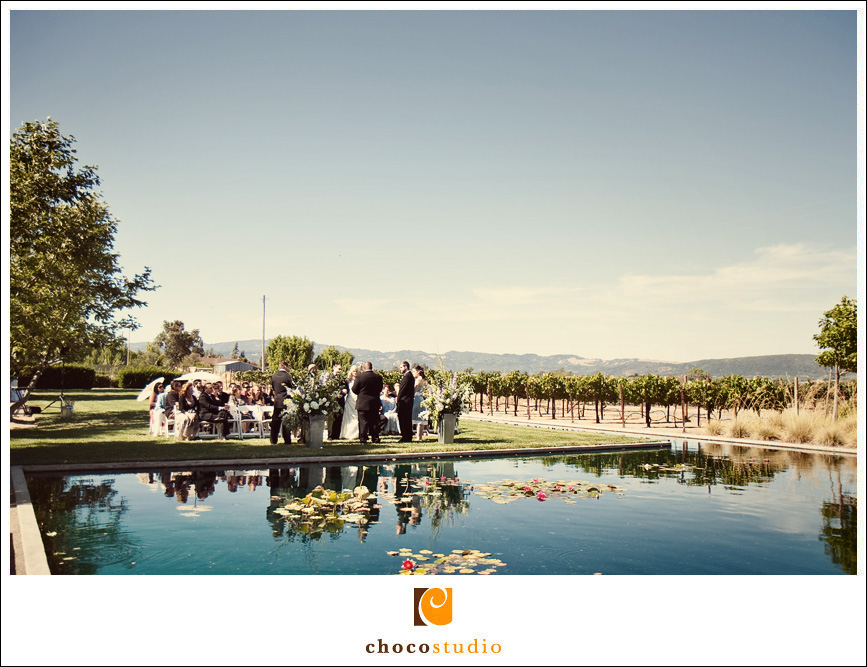 Outdoor ceremony with a view of the water and open sky