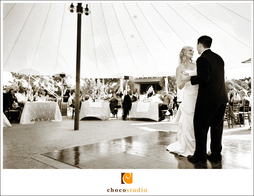 Bride and groom dancing under the tent