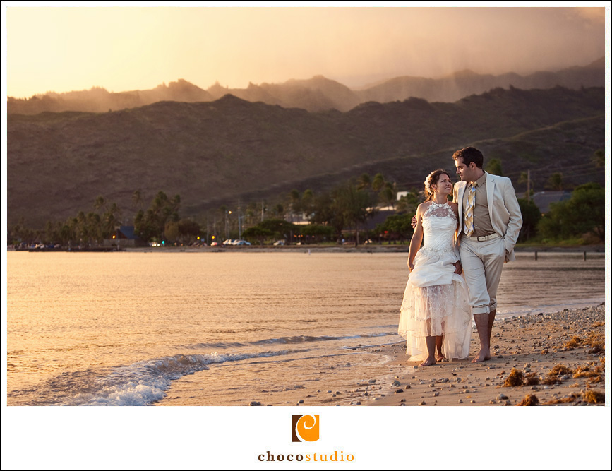 Bride and Groom Photo Walking on a Beach in Oahu Hawaii