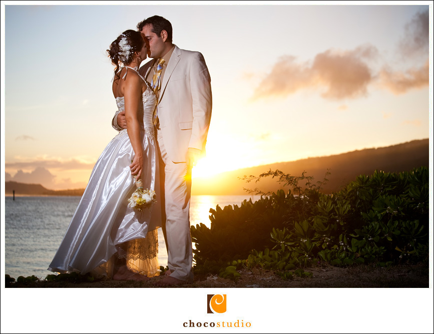 Sunset wedding photo of bride and groom in Hawaii