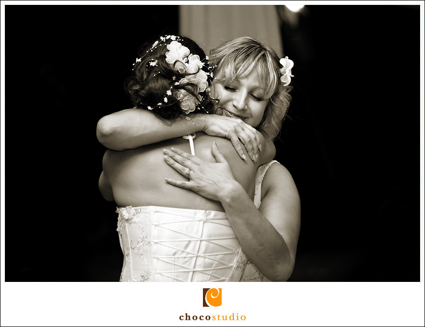 Maid of Honor and Bride Hugging