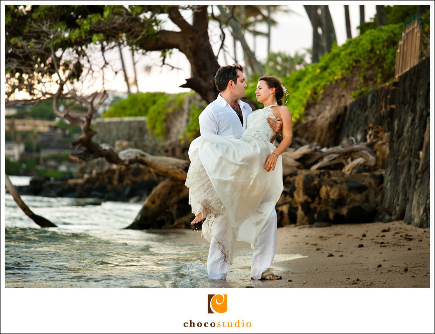 Groom carrying the bride on a beach