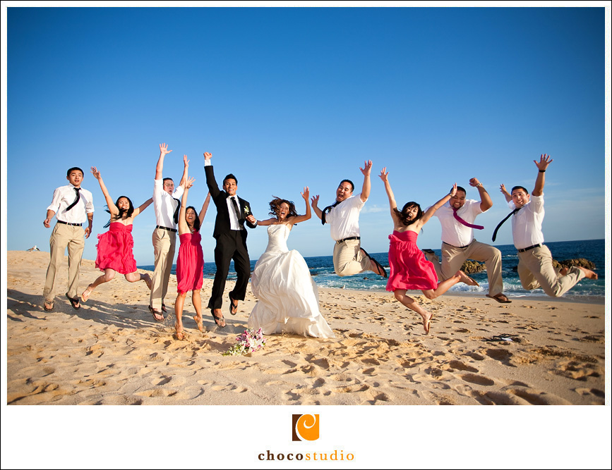 Bridal Party Jumping on the Beach