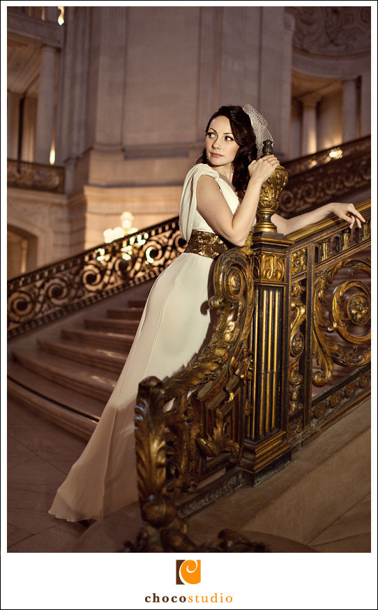 bride on the stairs of san francisco city hall