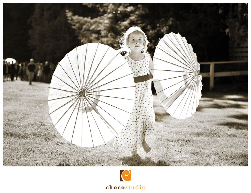 Playing on the Meadow with Parasols