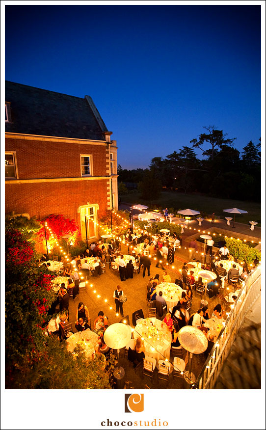 Outdoor evening wedding reception at Kohl Mansion at Dusk