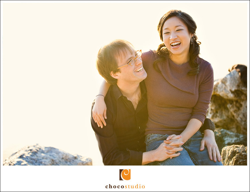 Portrait of a laughing couple in Half Moon Bay