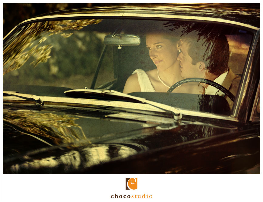 Romantic wedding portrait of a couple in their car