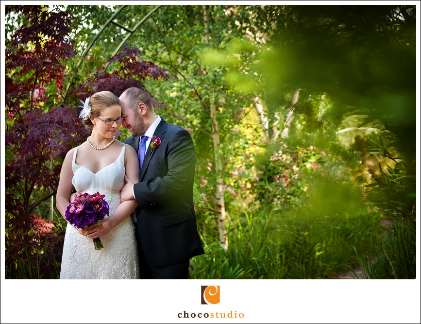 Wedding portrait in lush garden of Hans Fahden Vineyard