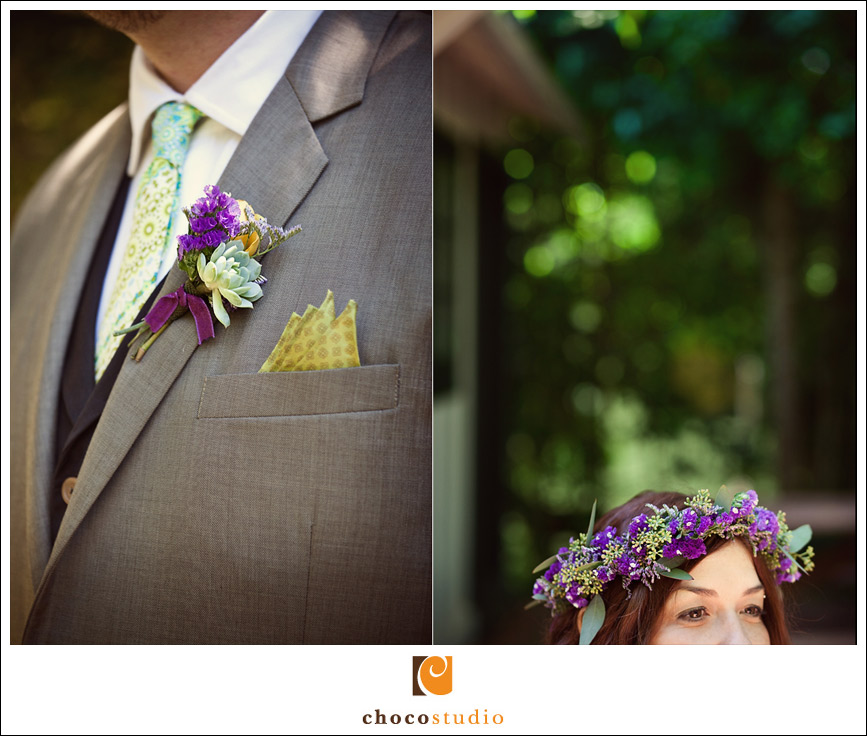 A boutonniere with succulents and purple flowers
