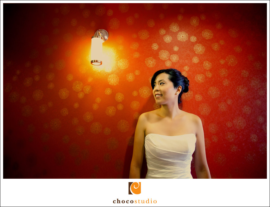 Portrait of a bride with a bright colored wall
