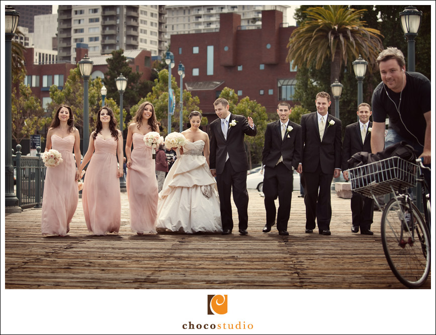 Bridal party on a pier in San Francisco with bike