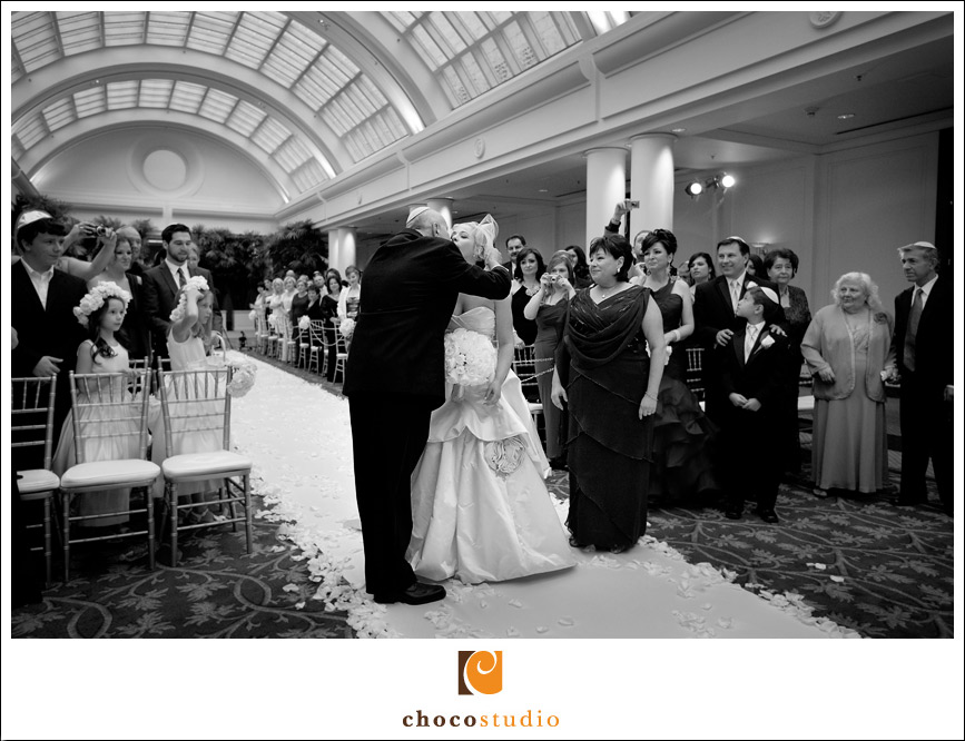 Dad kissing the bride before giving her away at wedding