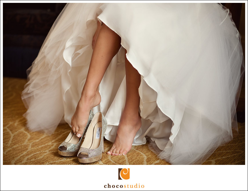 San Francisco bride putting shoes on