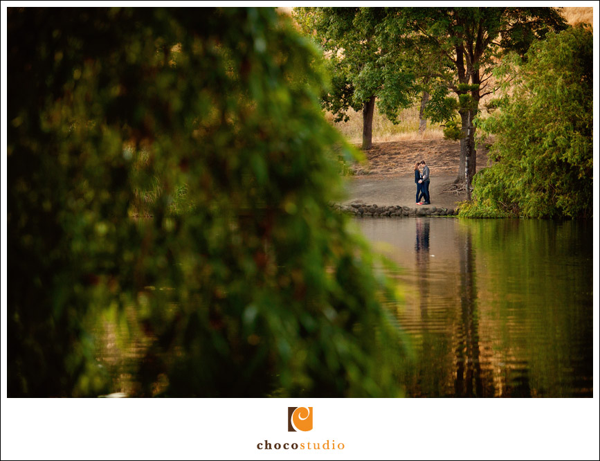 Engagement photo by a pond at Garin Park