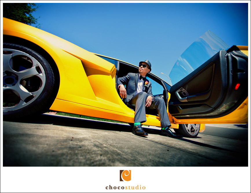 Portrait of groom in yellow Lamborghini