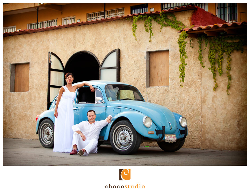 Bride and groom posing by Volkswagen Beetle Cabo San Lucas