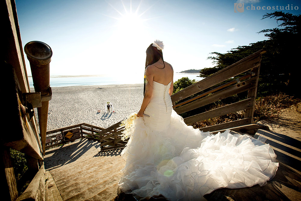 Bride coming down the isle at Carmel beach wedding ceremony