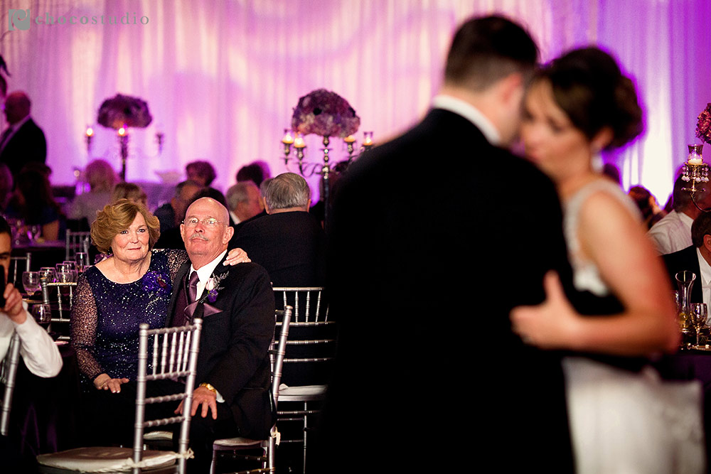 Emotional parents watching their daughter's first dance at Campbell wedding