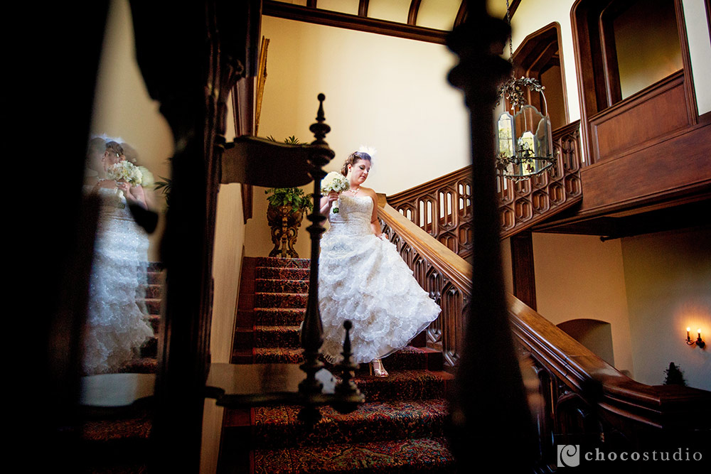 Bride coming down the staircase at Kohl Mansion wedding