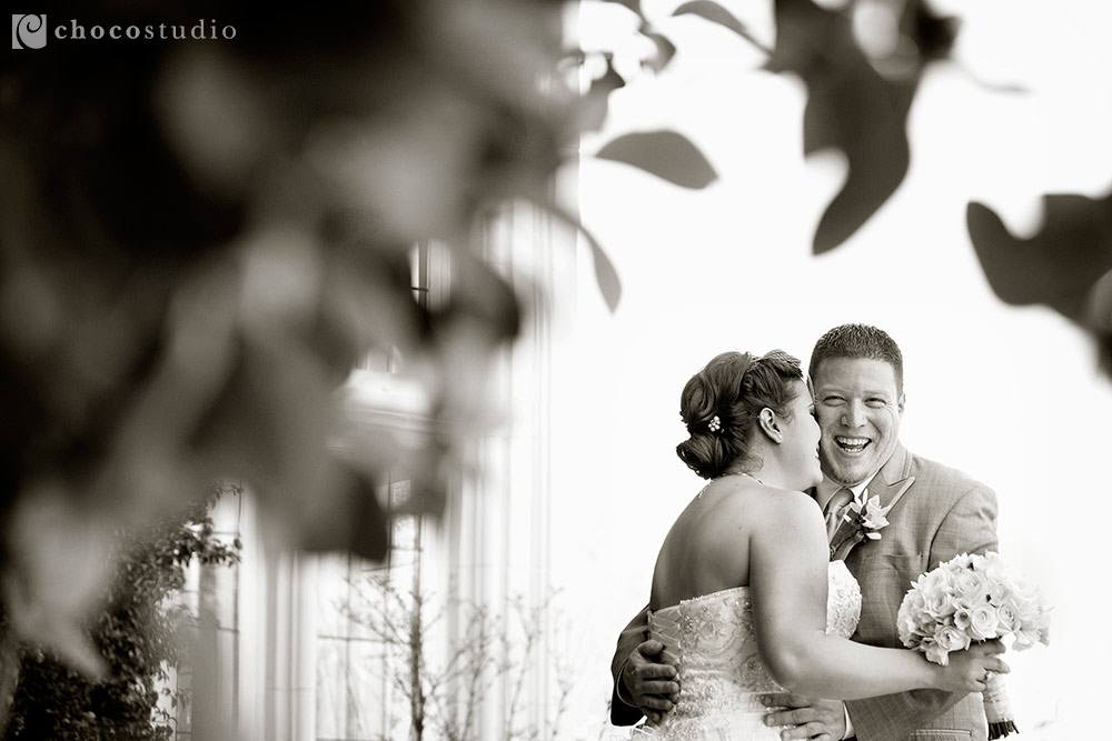 Laughing bride and groom at Kohl Mansion