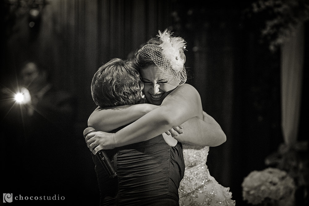 Bride and her mom during reception at Kohl Mansion