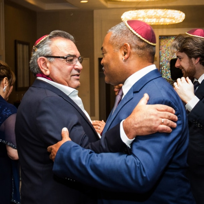 Two Dads Hugging after Ceremony at Union Square Marriott