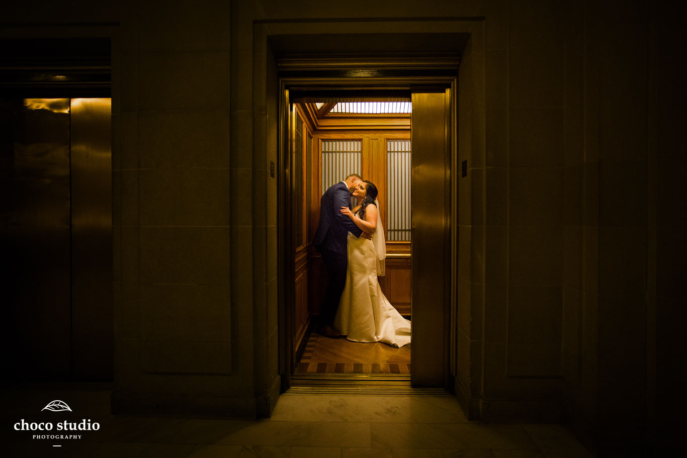 Intimate wedding portrait in San Francisco City Hall elevator