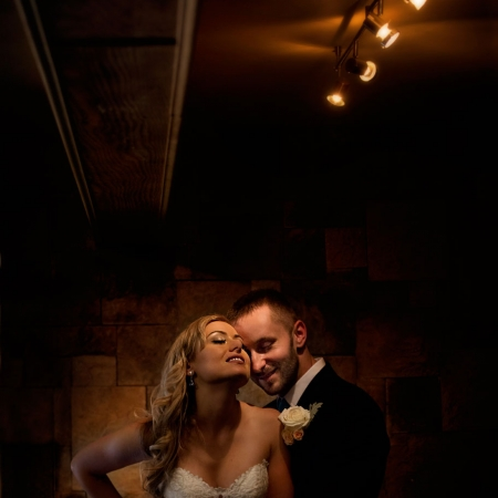 Vezer winery wedding barrel room portrait