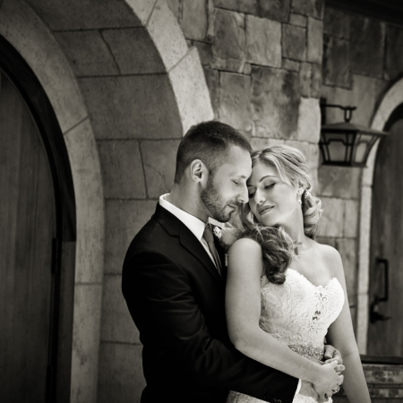 Intimate moody bride and groom portrait in front of Mankas Gardens Barrel Room during Vezer winery wedding