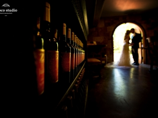 Bride and Groom out of focus portrait inside Mankas Gardens barrel room at Vezer winery wedding