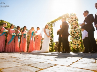 Summer midday wedding ceremony at Ranch Estate Vineyard Lookout at Vezer winery wedding