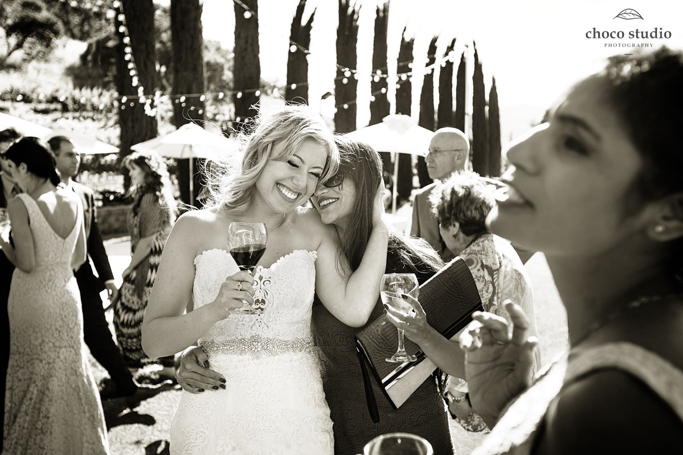 Emotional bride hugs wedding guests at Ranch Estate Vineyard Lookout and Courtyard at Vezer winery wedding