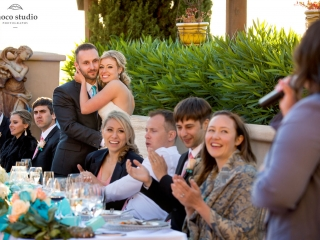 Bride and groom listening to toasts during reception at Ranch Estate Vineyard Lookout and Courtyard at Vezer winery wedding
