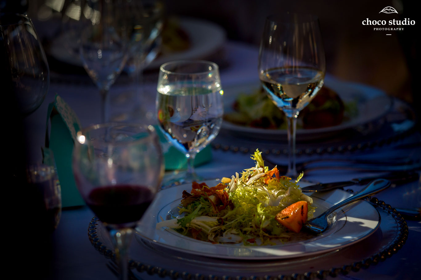 Table setting and salad at wedding reception at Ranch Estate Vineyard Lookout and Courtyard at Vezer winery wedding