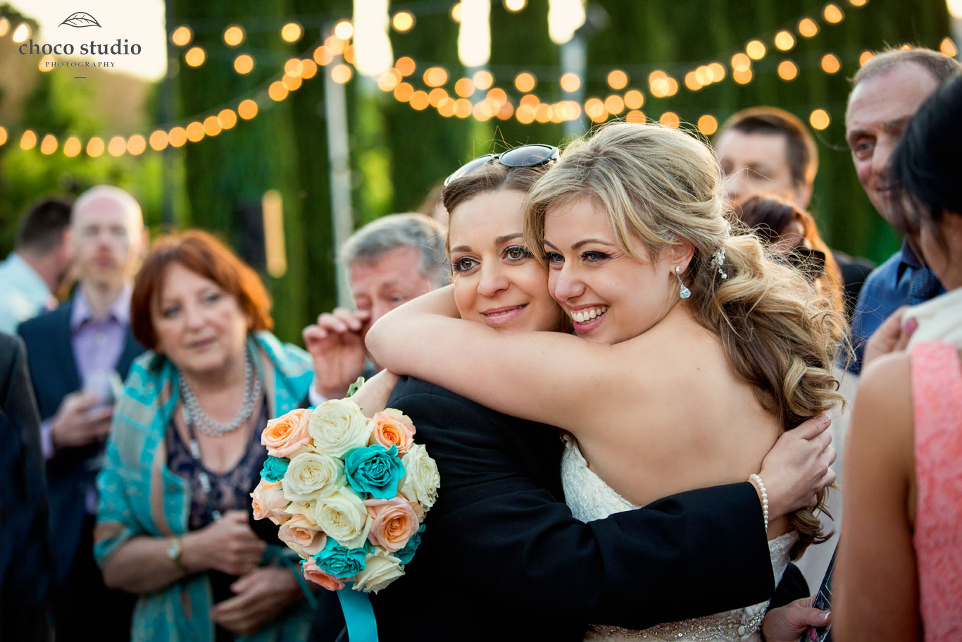 Bride hugging wedding guest at Ranch Estate Vineyard Lookout reception at Vezer winery wedding