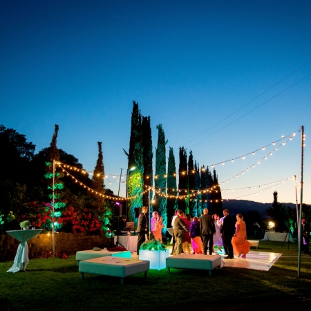 Twilight dancing at wedding reception at Ranch Estate Vineyard Courtyard at Vezer winery wedding